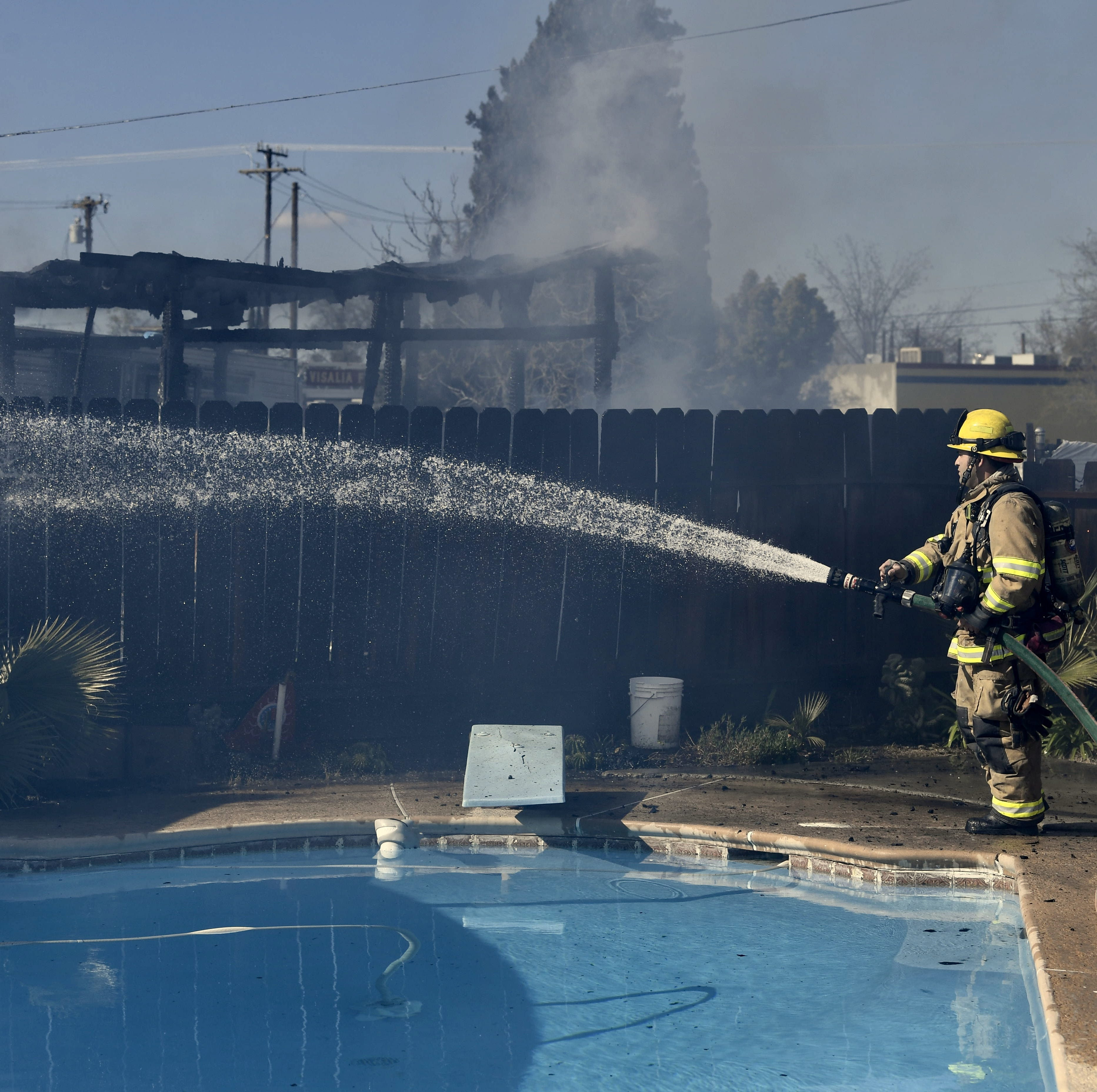 Shed fire causes smoke column in north Visalia