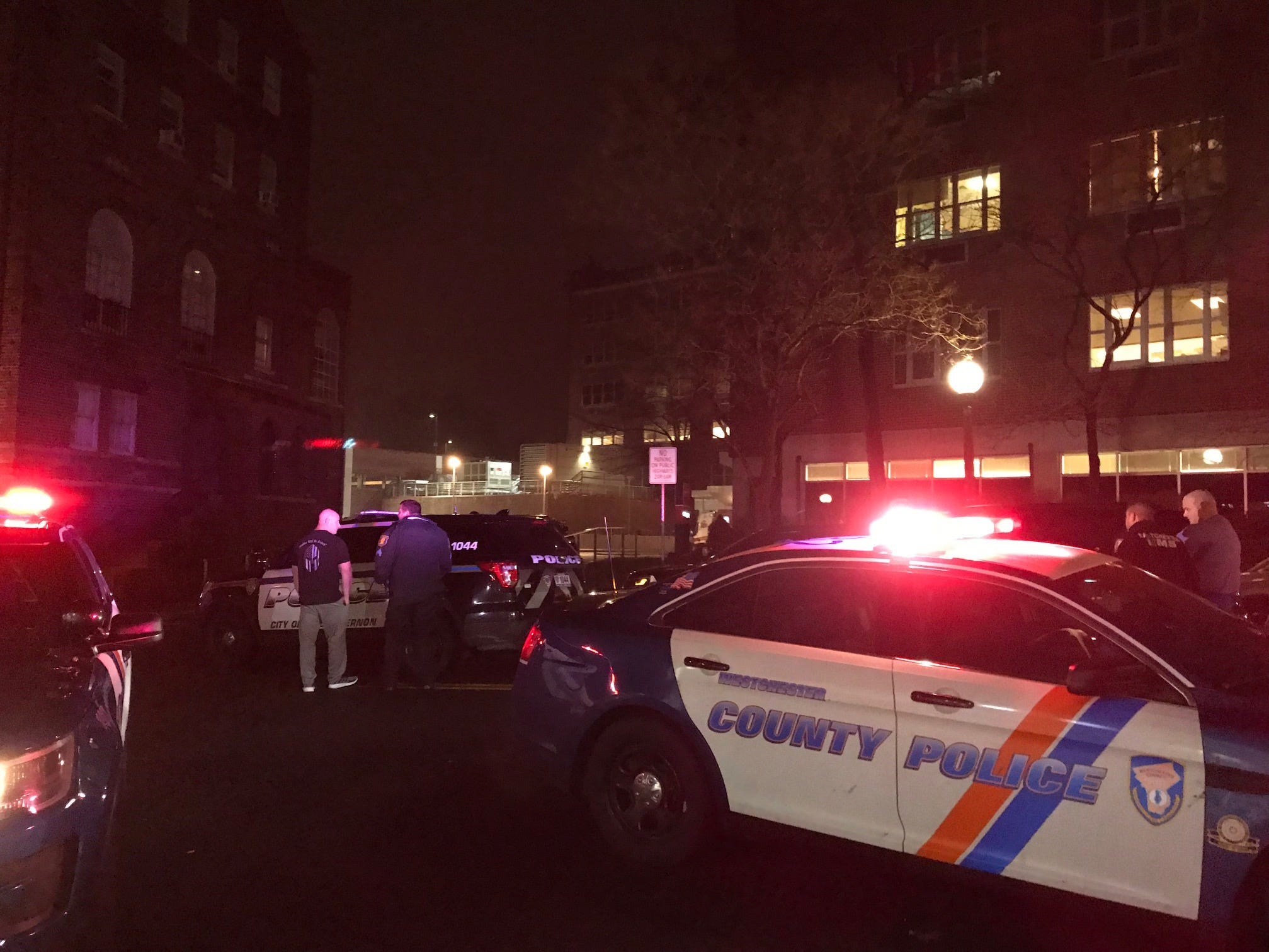 Various police agency staged outside of New York-Presbyterian Lawrence Hospital as a search for a reported man with a gun inside the building is underway, Sunday, March 10, 2019.
