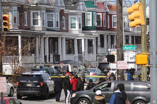 Police continue to investigate the crime scene on West 26th and North Market Street where two 17-year-olds were fatally shot Monday morning.