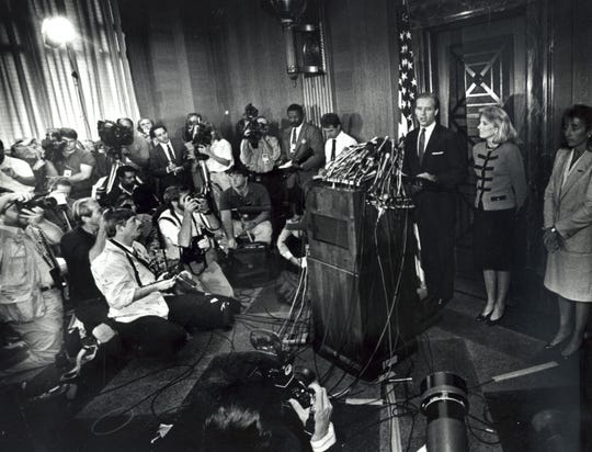 Sen. Joe Biden, with his wife Jill at his sides,  holds a press conference on Capitol Hill to announce his withdrawal from the presidential race on Sept. 23, 1987.