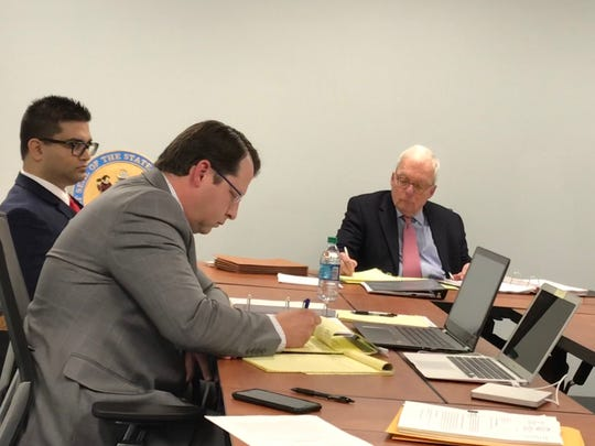 Dr. Nihar B. Gala, pictured left, is accused of trading prescriptions for sexual favors. At a hearing in March, his lawyer, Ben Schwartz, told hearing officer Roger Akin, pictured right, that his client denies the allegations.