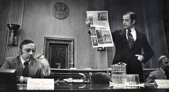 Sen. Joe Biden shows federal housing officials a newspaper page showing poor living conditions in West Laurel. Biden was fighting for federal funds for urban renewal efforts in the town. Feb. 22, 1973.