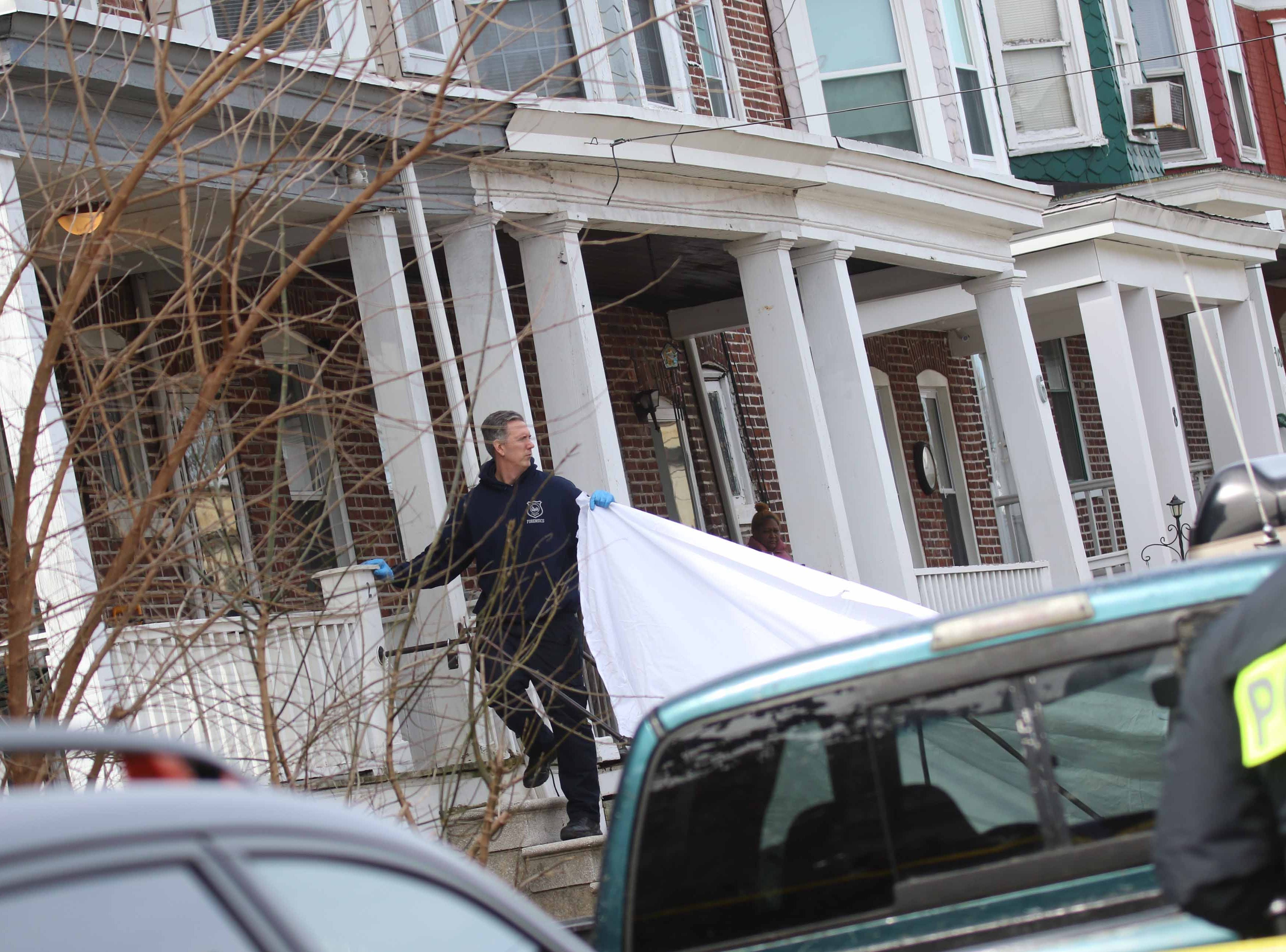 Police continue to investigate the crime scene on W. 26th and N. Market St. where two 17-year-olds were fatally shot Monday morning.