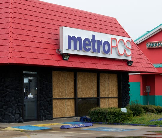 The Metro PCS store located in the 3200 block of Kemp Blvd. was one of three business that lost windows after an alleged suspect used a large metal pipe to break the windows Friday morning.