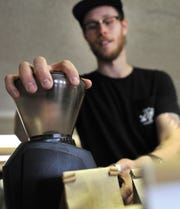 Loft Roasters Coffee CEO, Mason Wilson prepares to make coffee Monday morning. Wilson said they are looking to create an atmosphere that encourages meaningful conversations.