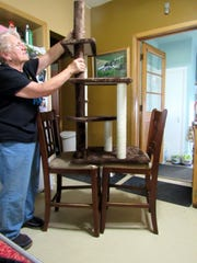 Susan Manzke assembles a cat tower in her kitchen last fall.