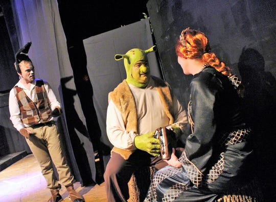 "Blake Nesselroad plays Donkey, Steve Hendershott is Shrek and Sarah Gantzer is Fiona in ""Shrek the Musical."" The cast of nearly 60 features new and seasoned thespians alike. The production by the Zane Trace Players opens March 15, at the Renner Theater."