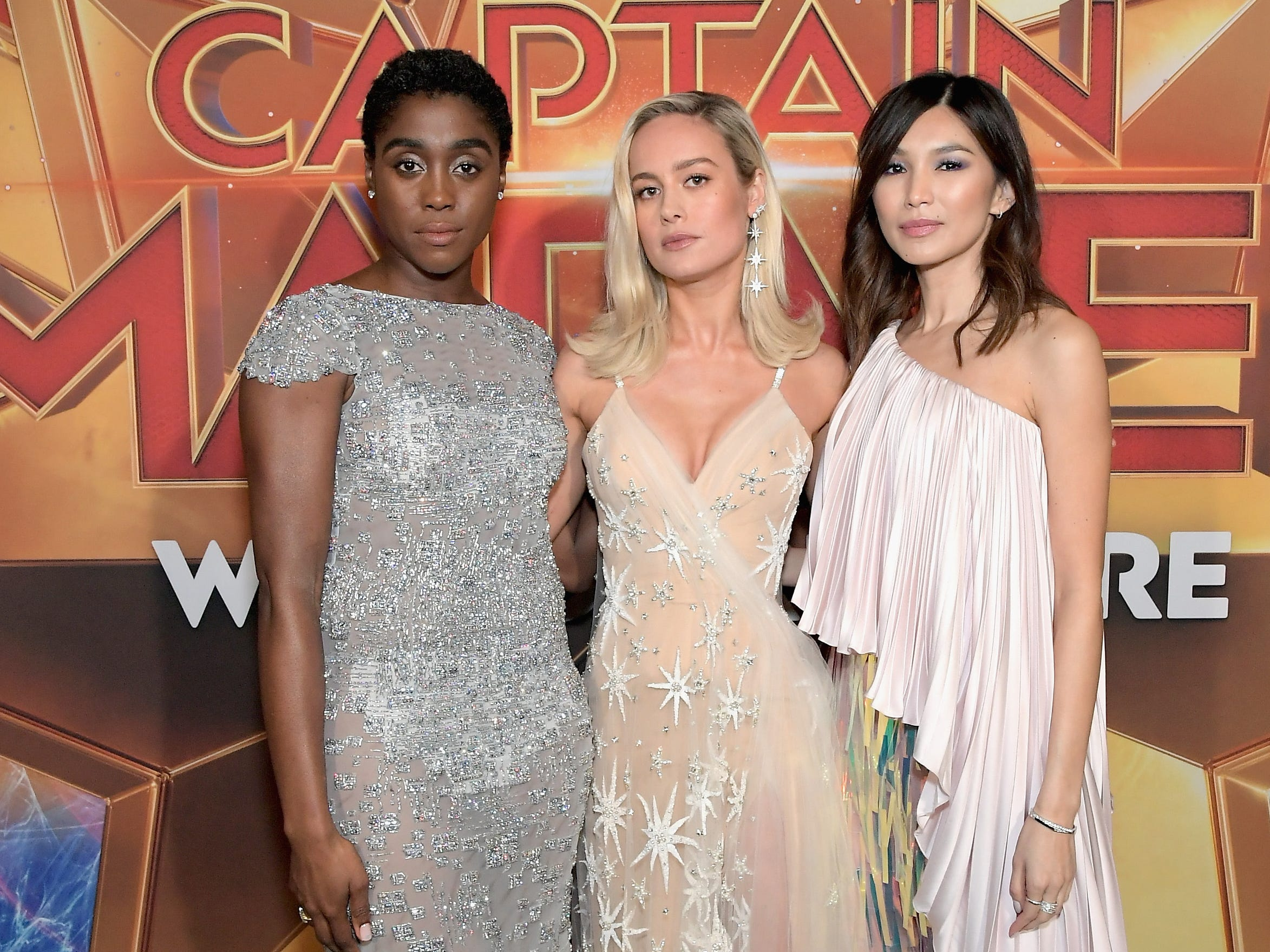 "Lashana Lynch, left, Brie Larson and Gemma Chan glam it up at the attend the world premiere of ""Captain Marvel"" at Dolby Theatre on March 4, 2019 in Hollywood."