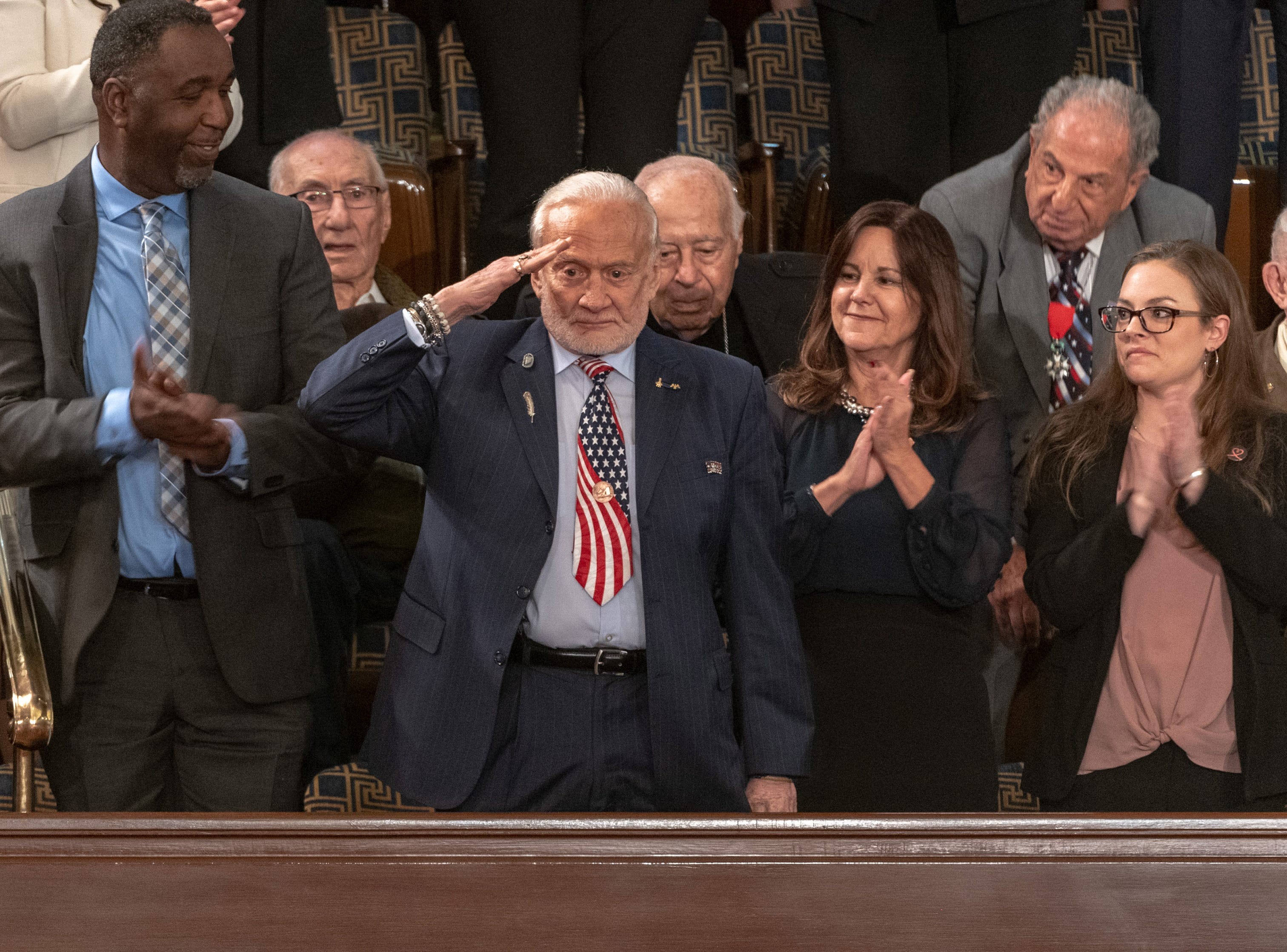 Former Aastronaut Buzz Aldrin salutes after being introduced at the 2019 State of the Union address in Washington D.C. Feb 5, 2019.