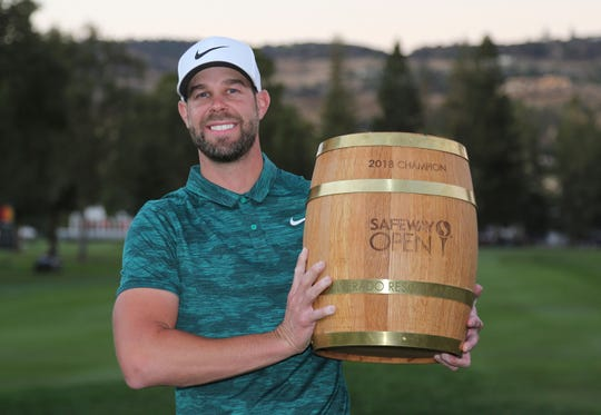 Kevin Tway poses with his trophy on the 18th green of the Silverado Resort North Course after winning the Safeway Open PGA golf tournament last October in Napa, Calif.