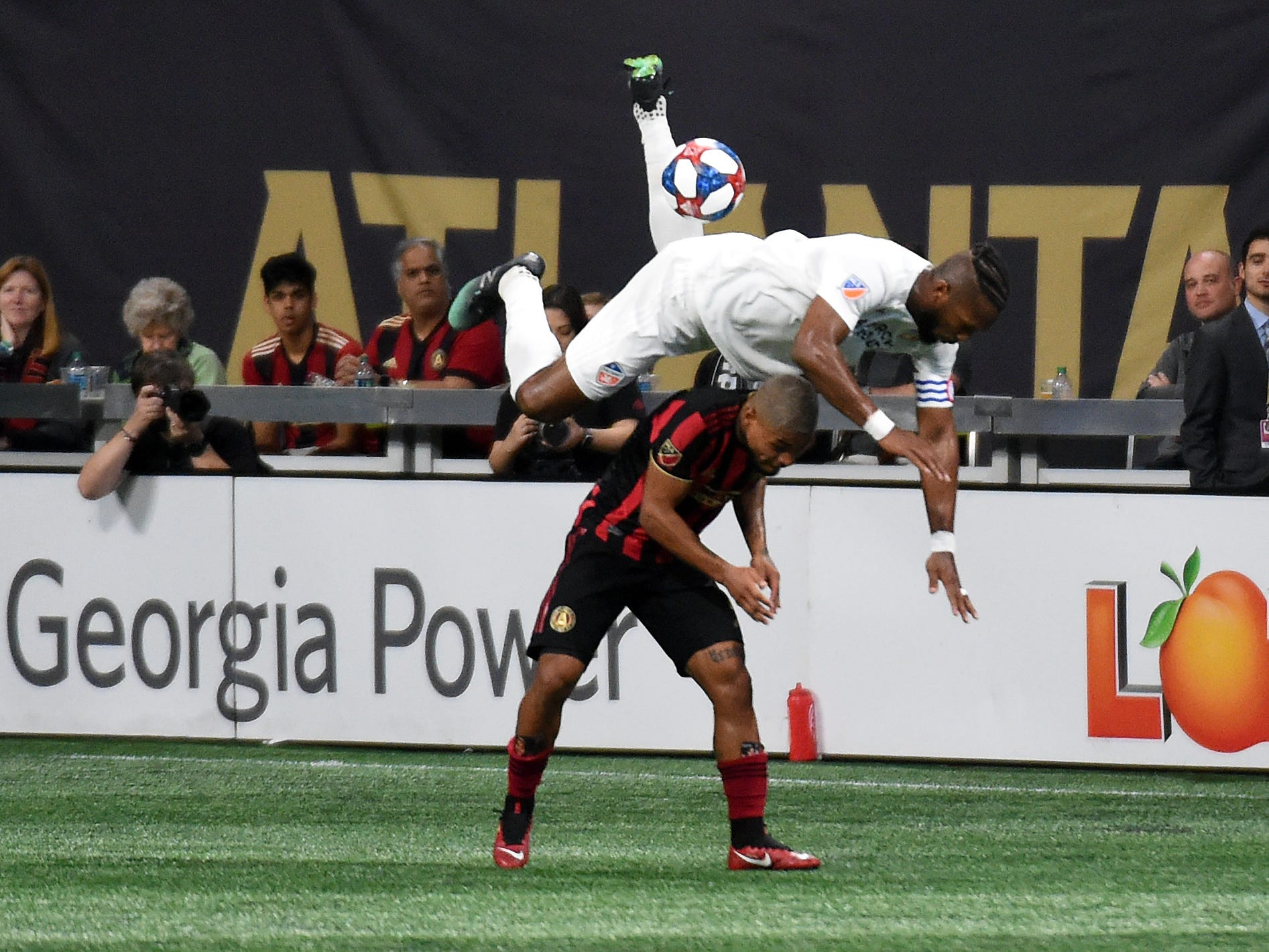 March 10: FC Cincinnati defender Kendall Waston (2) goes up for ball over Atlanta United forward Josef Martinez (7) during the second half at Mercedes-Benz Stadium.