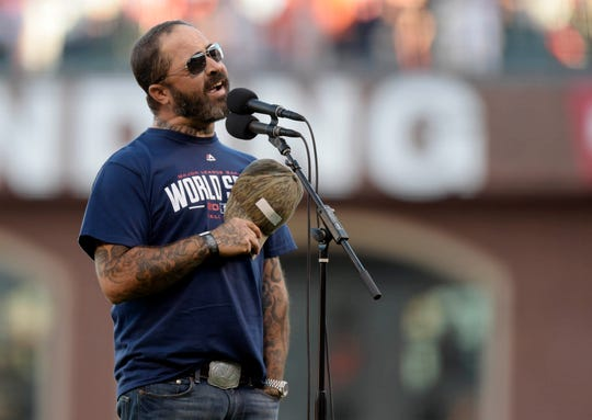 Recording artist Aaron Lewis performs the national anthem before game five of the 2014 World Series at AT&T Park.