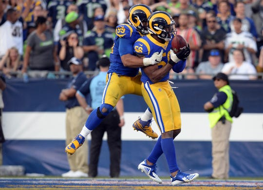 Dante Fowler (56) joined the Rams in October, much to the delight of Aaron Donald (99).