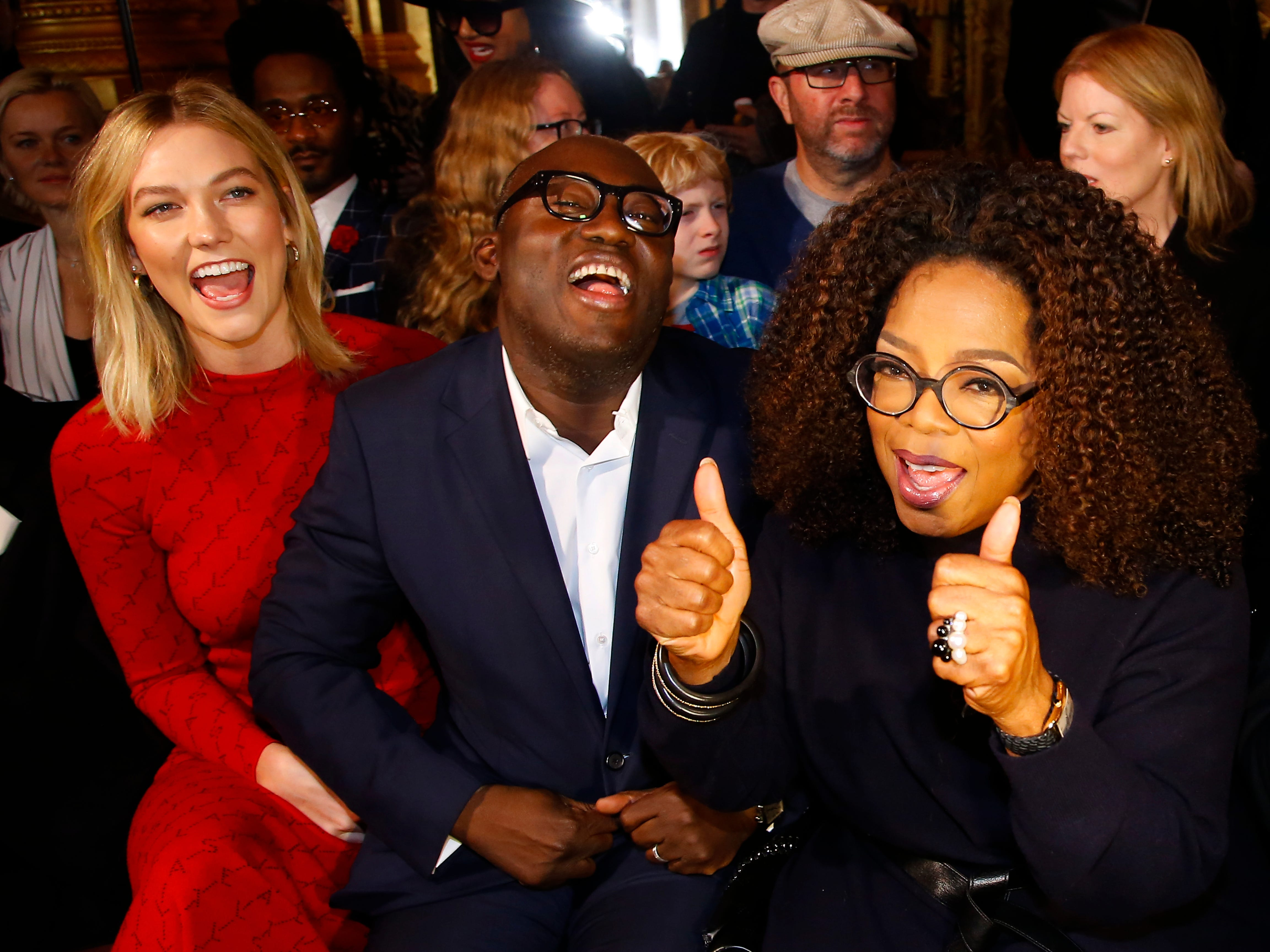 Model Karlie Kloss, left, British Vogue editor Edward Enninful, center, and Oprah Winfrey amuse themselves before the start of Stella McCartney's Paris Fashion Week show on March 4, 2019.