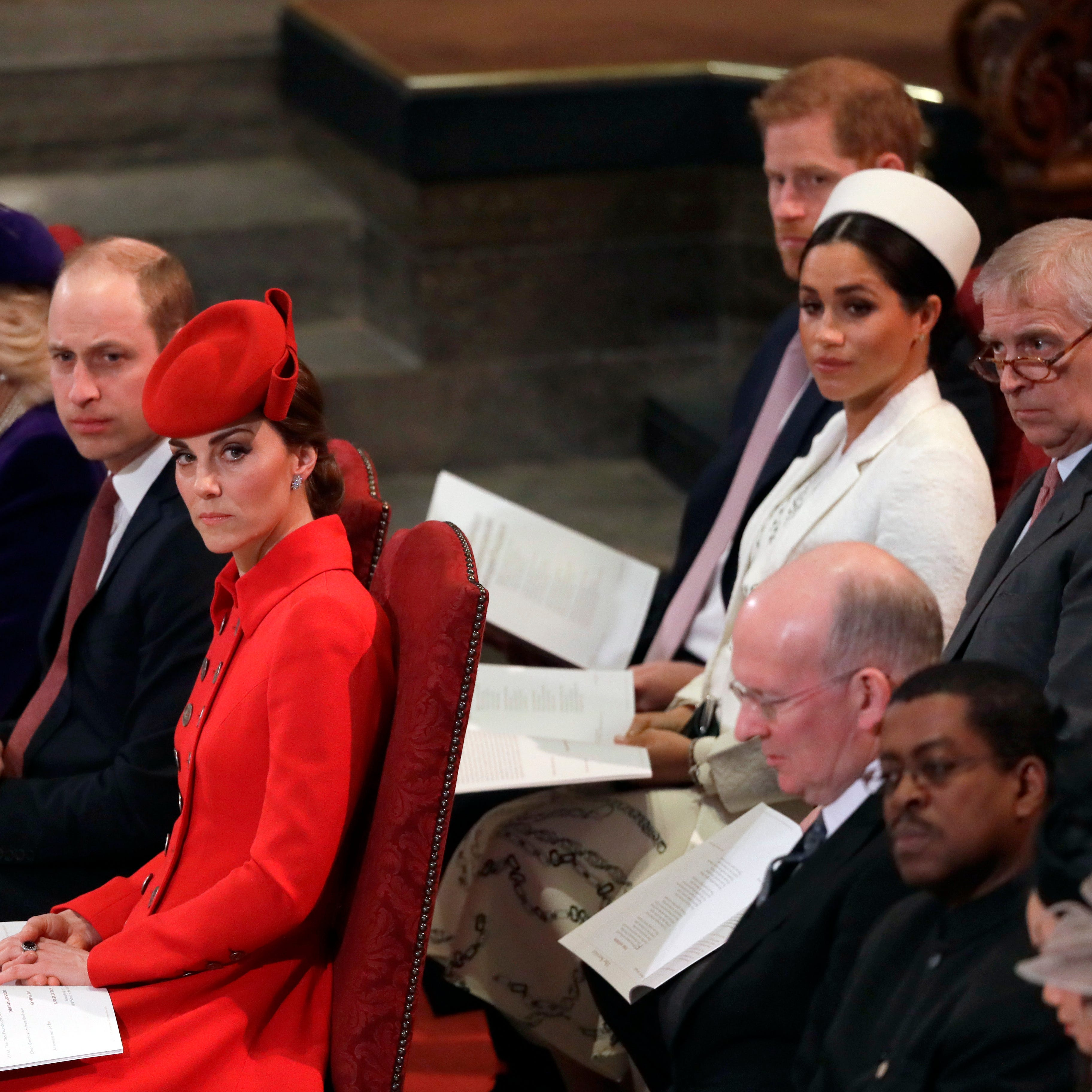 Duchess Kate of Cambridge, sits with Prince William, Duchess Camilla of Cornwall and Prince Charles in front row, with Prince Harry, Duchess Meghan of Sussex and Prince Andrew behind them, at the Commonwealth Service at Westminster Abbey, March 11, 2019.