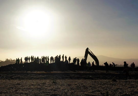 Rescue and recovery personnel use an earth mover to recover debris from a crater where Ethiopian Airlines Flight 302 crashed in a wheat field just outside the town of Bishoftu, 62 kilometers southeast of Addis Ababa on March 10, 2019 in Addis Ababa, Ethiopia. Flight 302 was just 6 minutes into its flight to Nairobi, Kenya, when it crashed killing all 157 passengers and crew on board. The cause of the crash has not yet been determined.