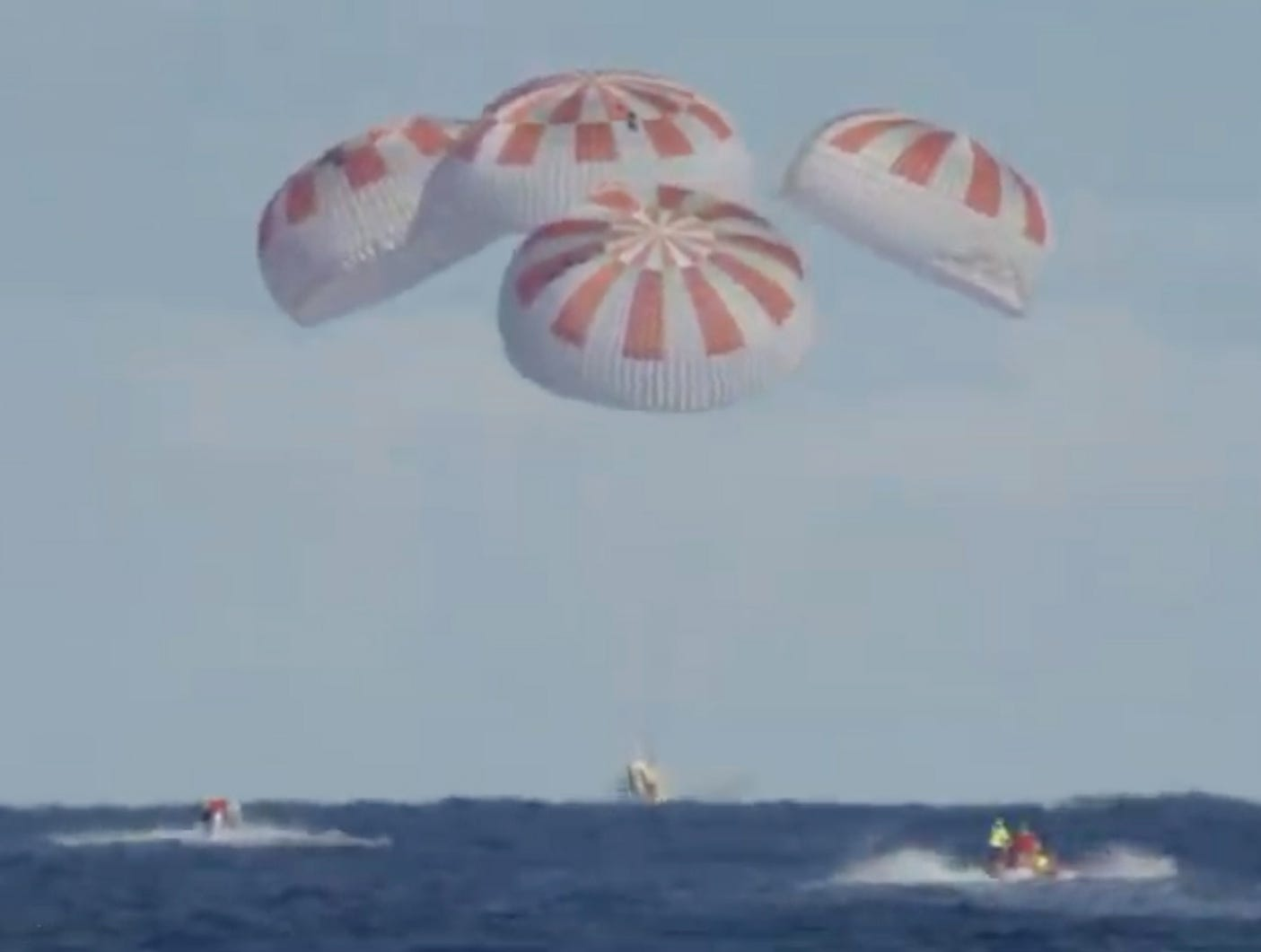 A grab taken from a NASA TV live feed shows SpaceX's Dragon capsule splash down in the Atlantic Ocean, from the International Space Station March 8,  2019. The Crew Dragon docked autonomously to the orbiting laboratory, a historic first for a commercially built and operated US crew spacecraft.
