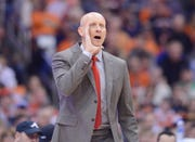 Chris Mack shouts during a game in his debut season at Louisville.
