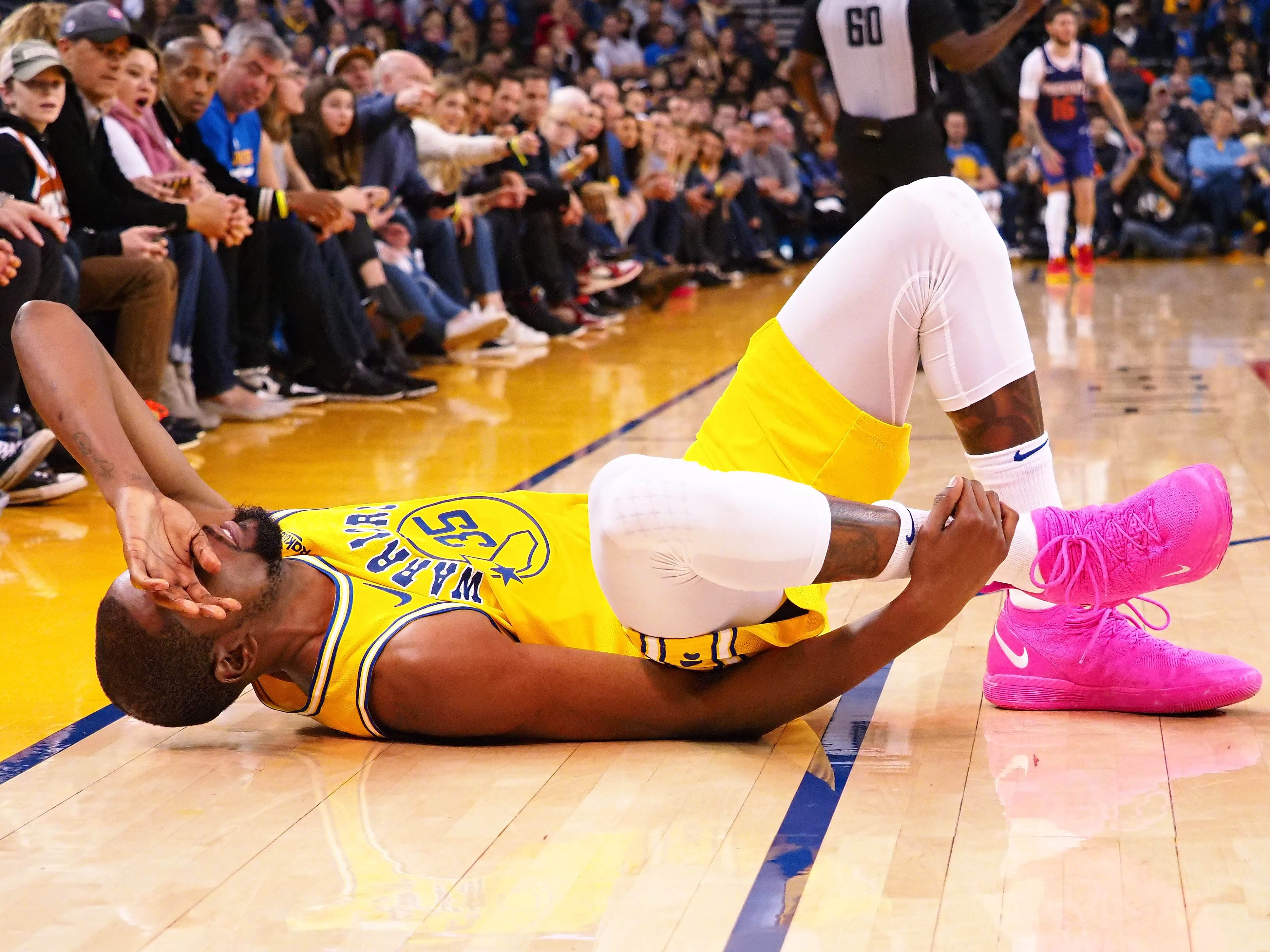 March 10: Warriors star Kevin Durant clutches his ankle in pain after going down during the fourth quarter against the Suns at Oracle Arena.