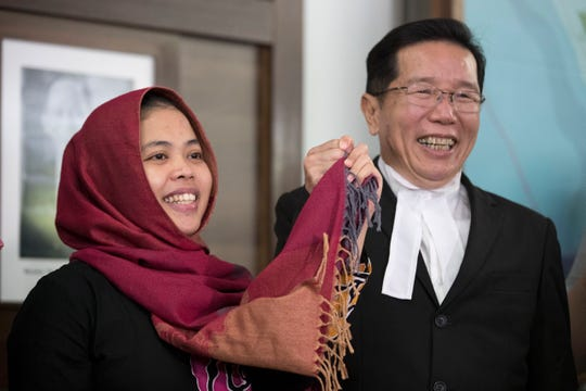 Indonesian Siti Aisyah, left, smiles with her lawyer Gooi Soon Seng after a press conference at Indonesian Embassy in Kuala Lumpur, Malaysia, on Monday.