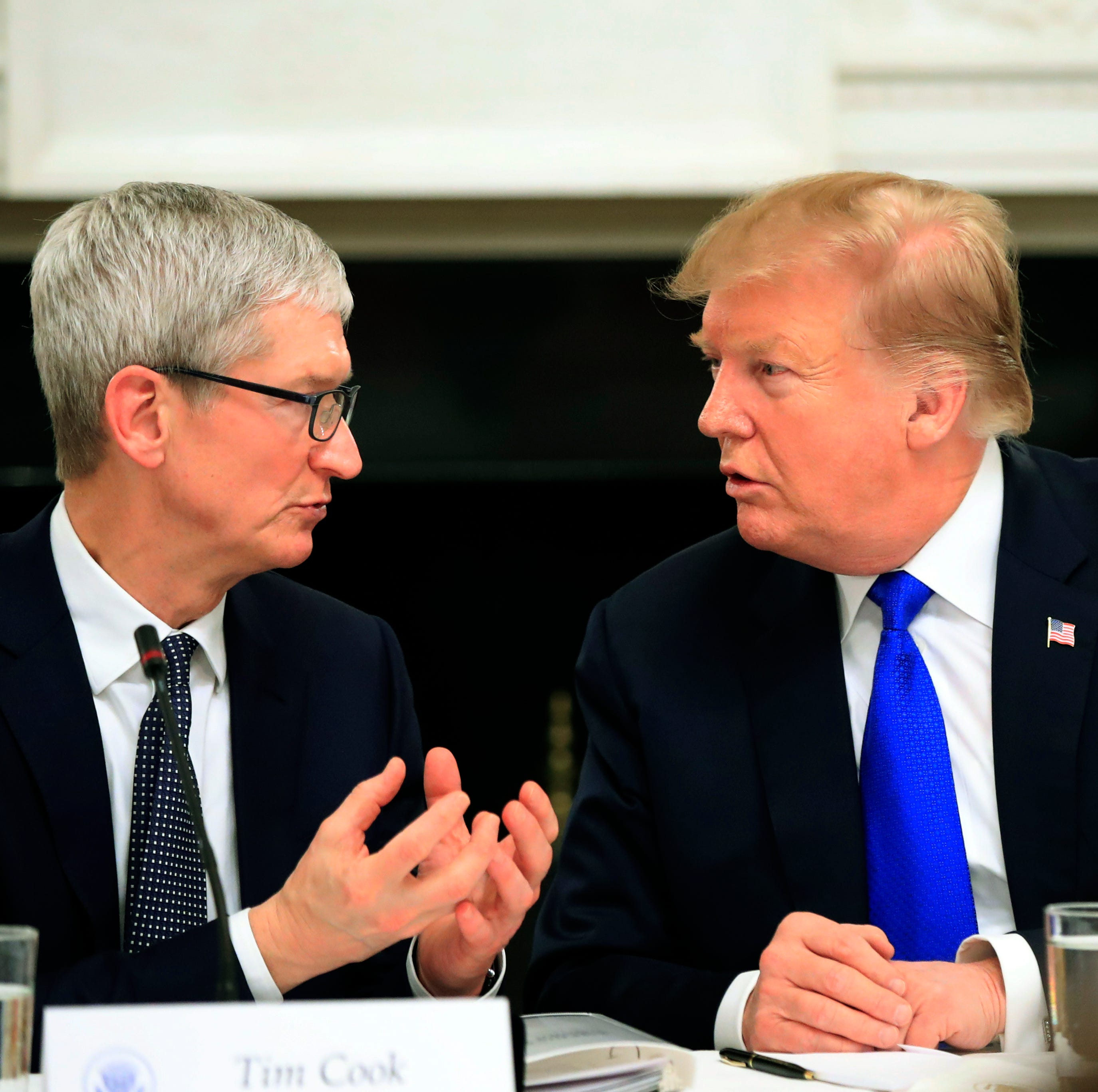 President Donald Trump talks to Apple Inc. CEO Tim Cook during a White House event last week.