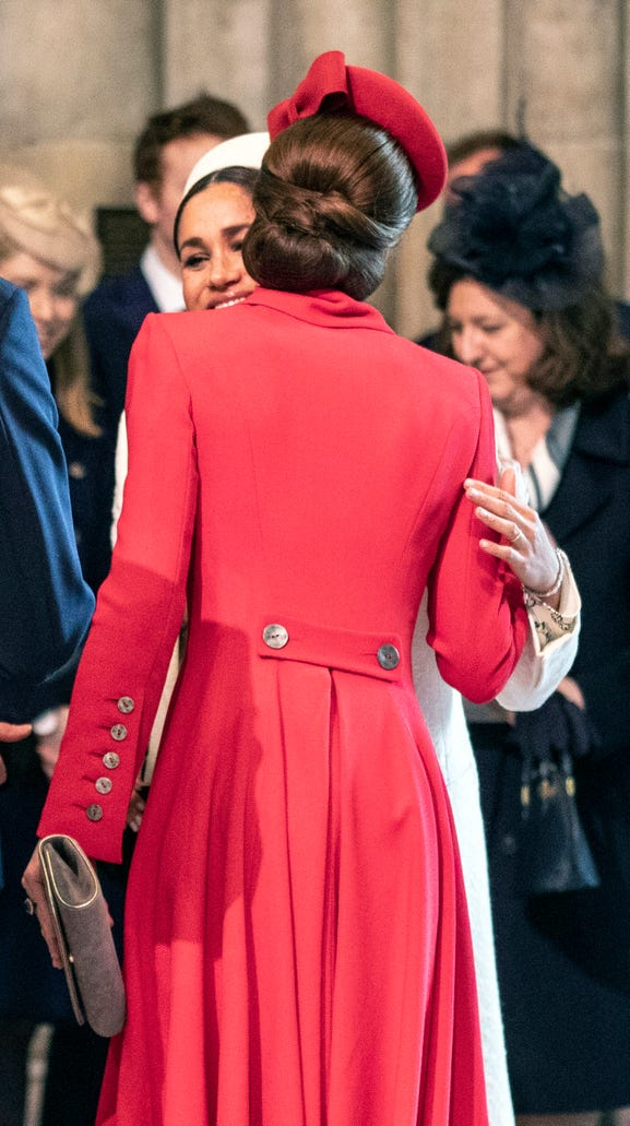 Duchess Kate of Cambridge greets sister-in-law Duchess Meghan of Sussex at the Commonwealth Day service at Westminster Abbey, March 11, 2019.