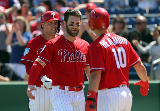 Bryce Harper and JT Realmuto make the Phillies a favorite to reach the postseason.