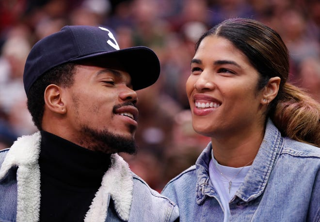 Chance The Rapper and Kirsten Corley share a laugh while attending a preseason NBA basketball game on Oct. 8, 2017, in Chicago.