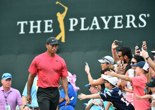 Tiger Woods walks up to the 18th tee box during the final round of The Players Championship in 2018.