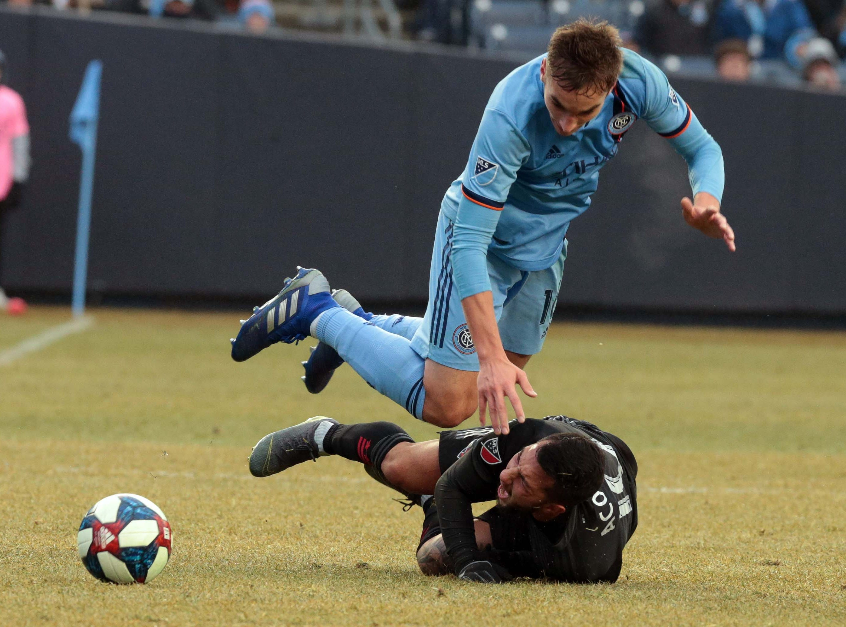 March 10: New York City midfielder James Sands (16) battles for the ball with D.C. United midfielder Luciano Acosta (10) during the second half at Yankee Stadium.
