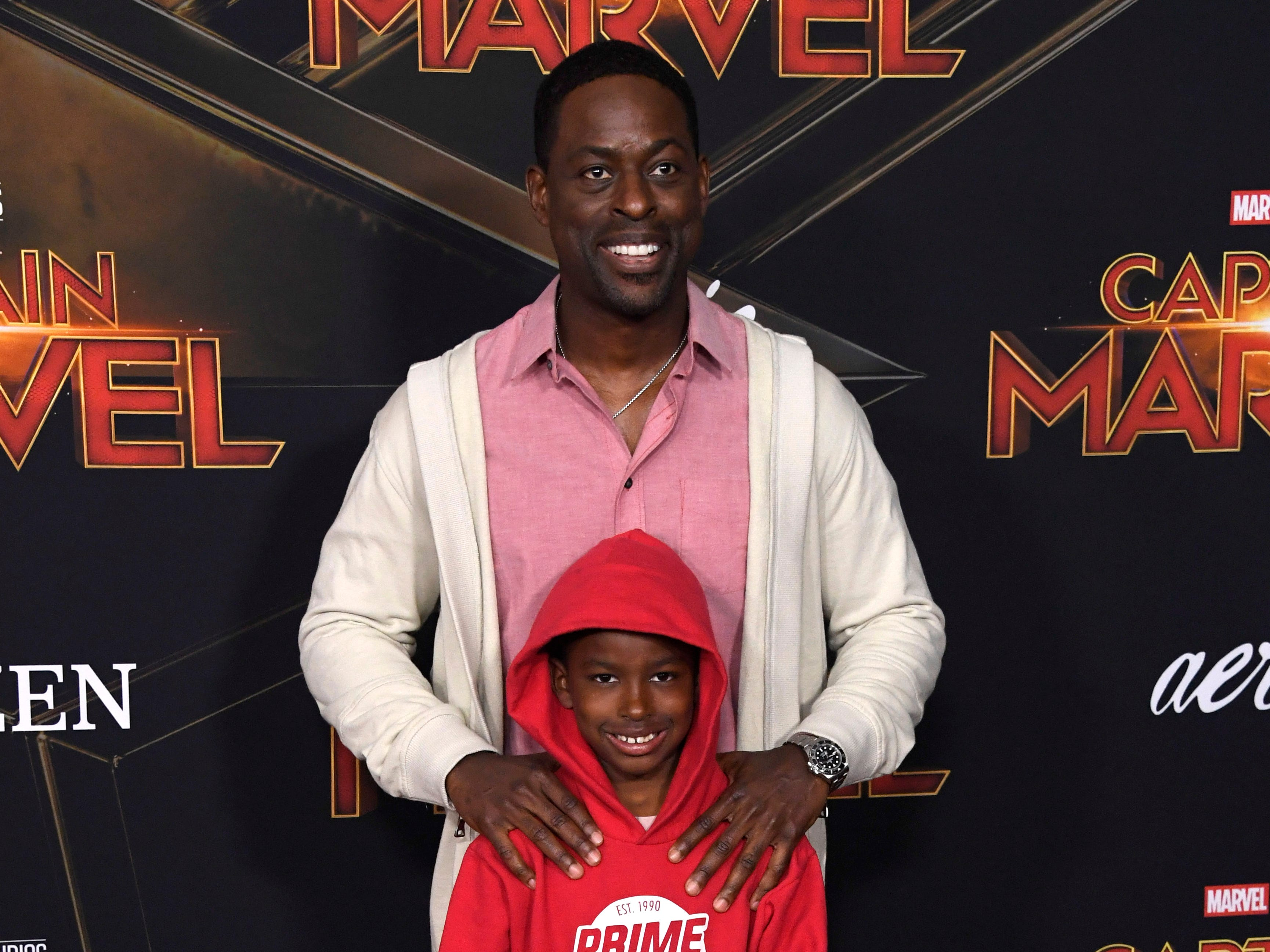 """This Is Us"" star Sterling K. Brown's ""Black Panther"" character may be dead but that didn't stop him and his son Andrew from hitting the ""Captain Marvel"" premiere."