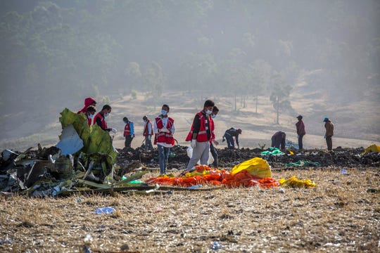 Rescuers work at the scene of an Ethiopian Airlines flight crash near Bishoftu, or Debre Zeit, south of Addis Ababa, Ethiopia, Monday, March 11, 2019.