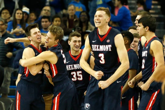 The Belmont Bruins celebrate their 74-72 win over the UCLA Bruins at Pauley Pavilion on December 15.