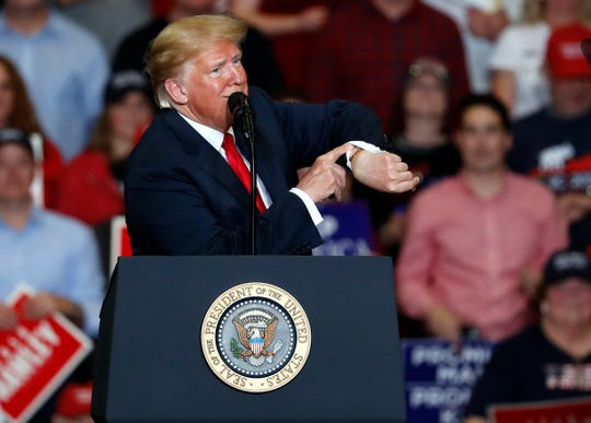 President Donald Trump looks at his watch near the end of a campaign rally Monday, Nov. 5, 2018, in Cape Girardeau, Mo.