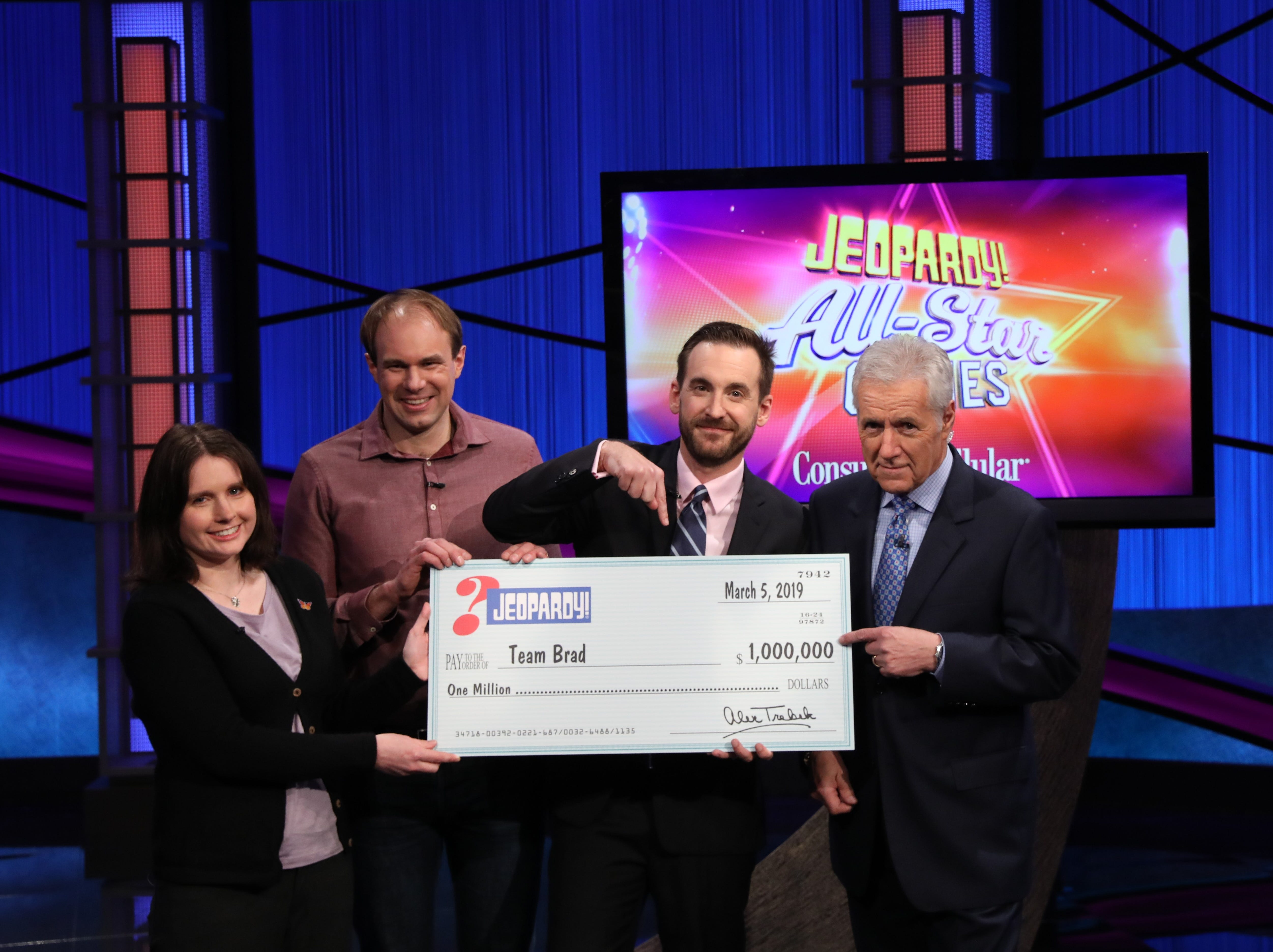 "Brad Rutter and teammates Larissa Kelly and David Madden split the top prize during the first-ever ""Jeopardy!"" team championship on the quiz show's ""All-Star Games,"" seen here with host Alex Trebek on March 5, 2019."