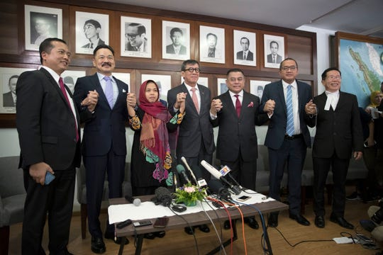 Indonesian Siti Aisyah, third from left, poses for a photo with officials from Indonesian Embassy on Monday. The Indonesian woman held two years on suspicion of killing North Korean leader's half brother Kim Jong Nam was freed from custody after prosecutors unexpectedly dropped the murder charge against her.