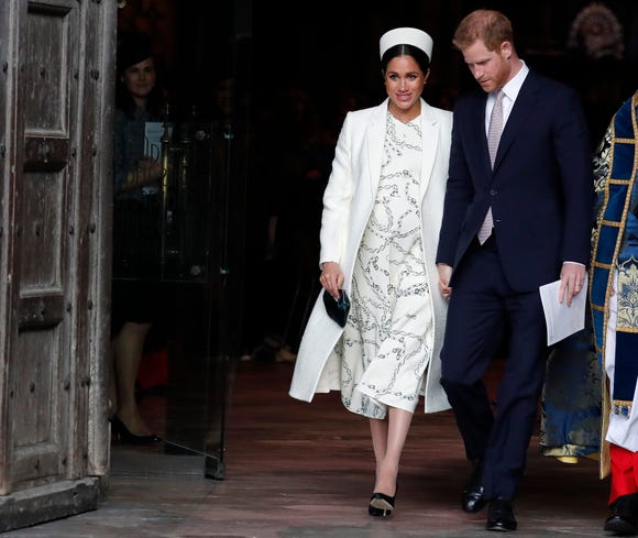 Duchess Meghan of Sussex and Prince Harry leave after attending the Commonwealth Service at Westminster Abbey on Commonwealth Day, March 11, 2019.