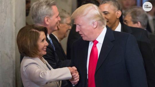 Nancy Pelosi greets Donald Trump.
