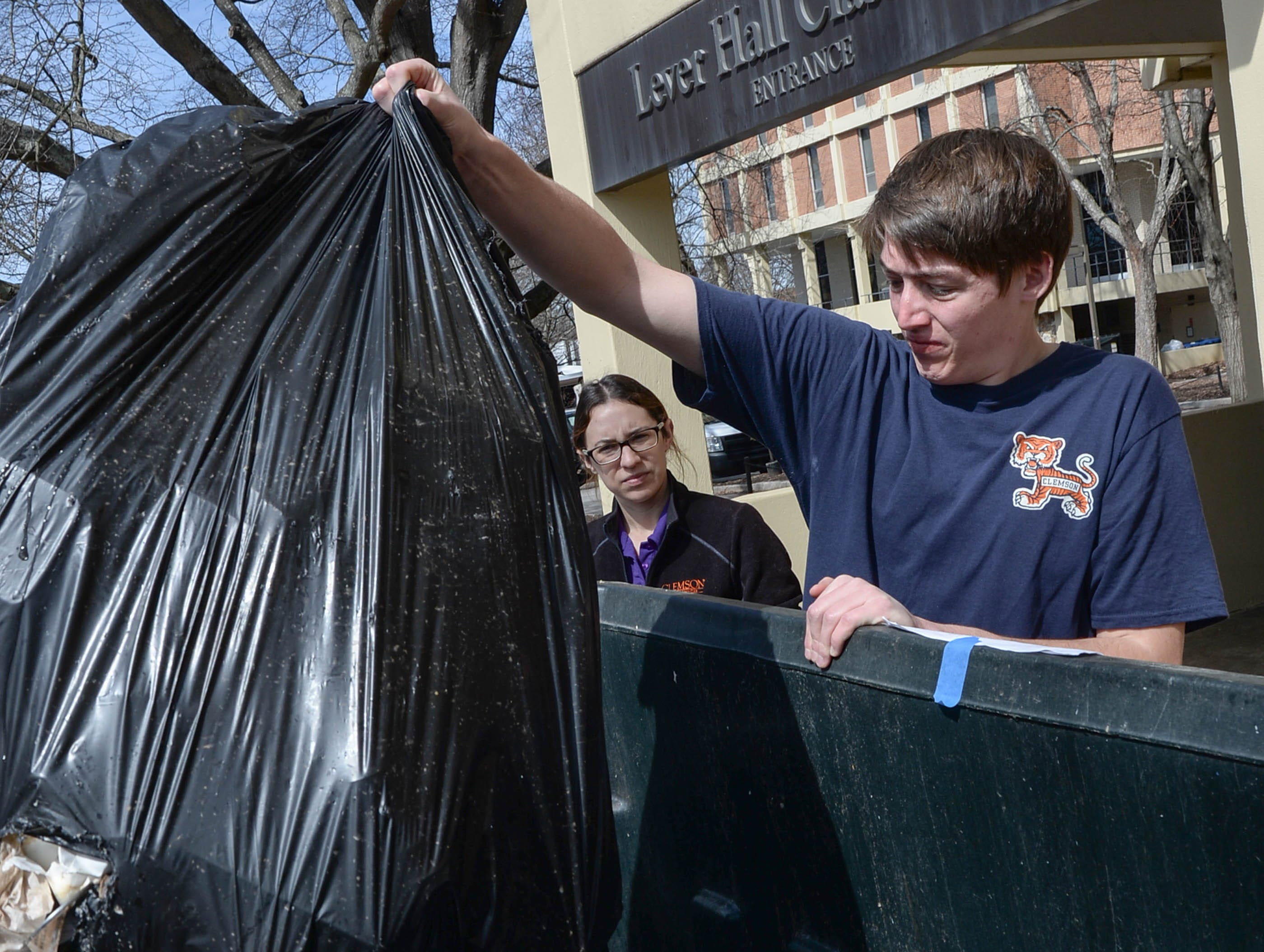 Clemson University student Caleb Todd, right, and Brittany Morra, left, collect trash during a study of student recycle habits. The waste audit, part of the annual RecycleMania competition with Universities across the country found from a sample study that Clemson students who recycle plastic and cans are good at doing so, said Brittany Morra, leading the March 12 study between Manning and Byrnes Hall tower dormitories.