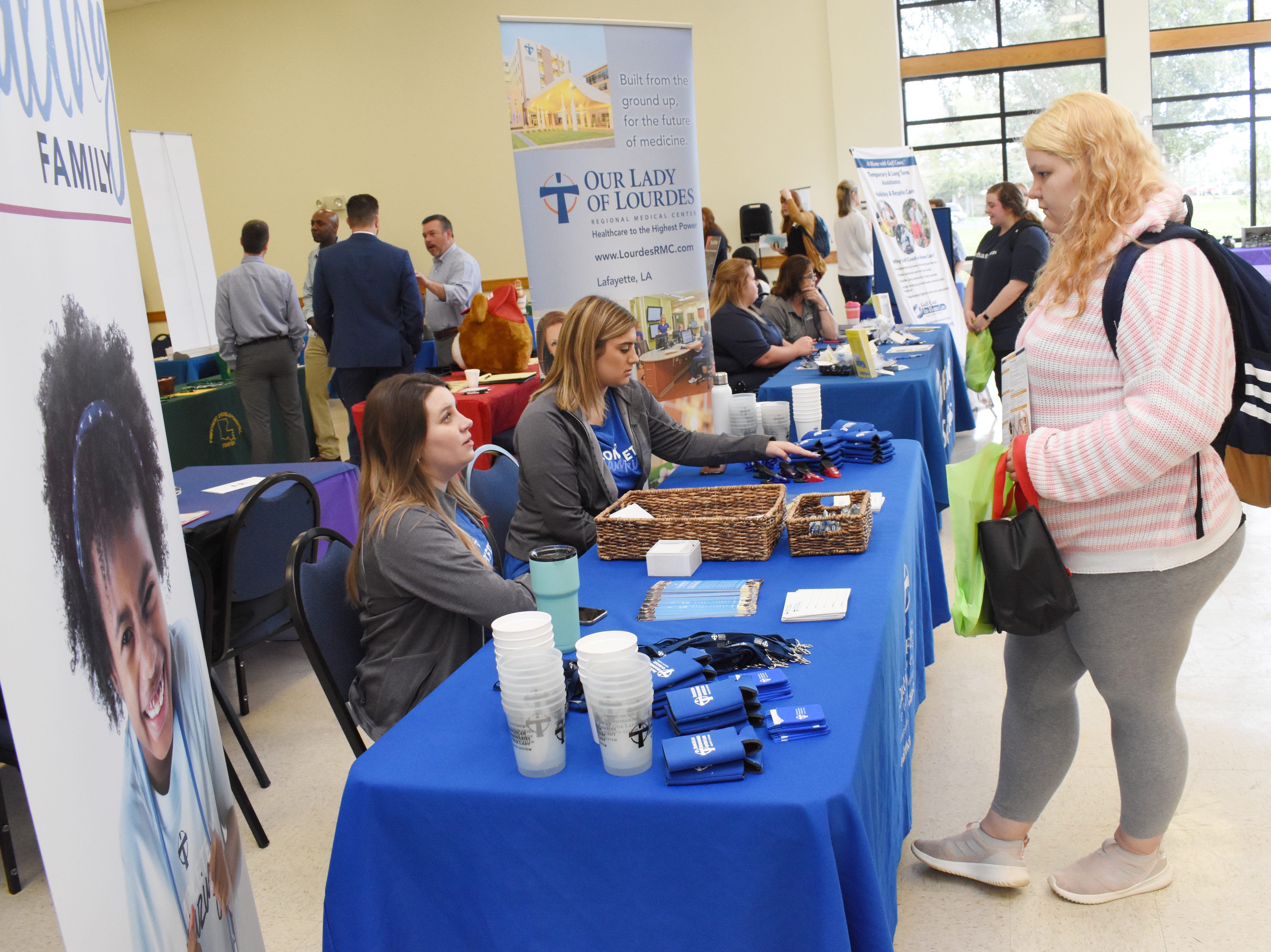 Haley Dixon (far left) and Sarah Gonzales, both with Our Lady of Lourdes Regional Medical Center in Lafayette, talk to LSUA senior psychology manger Morgan Merrell (right) at the Spring Career Fair held Tuesday, March 12, 2019 on the LSUA campus. About 40 businesses such as those involved in education, health care, non-profits and law enforcement were on hand to talk to students and others about job opportunities.