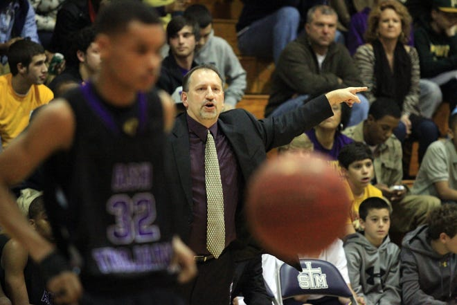 Former Alexandria Senior High coach Alan Tinsley coaches his team in a 2012 games against St. Thomas More. Tinsley and the school parted ways Tuesday.