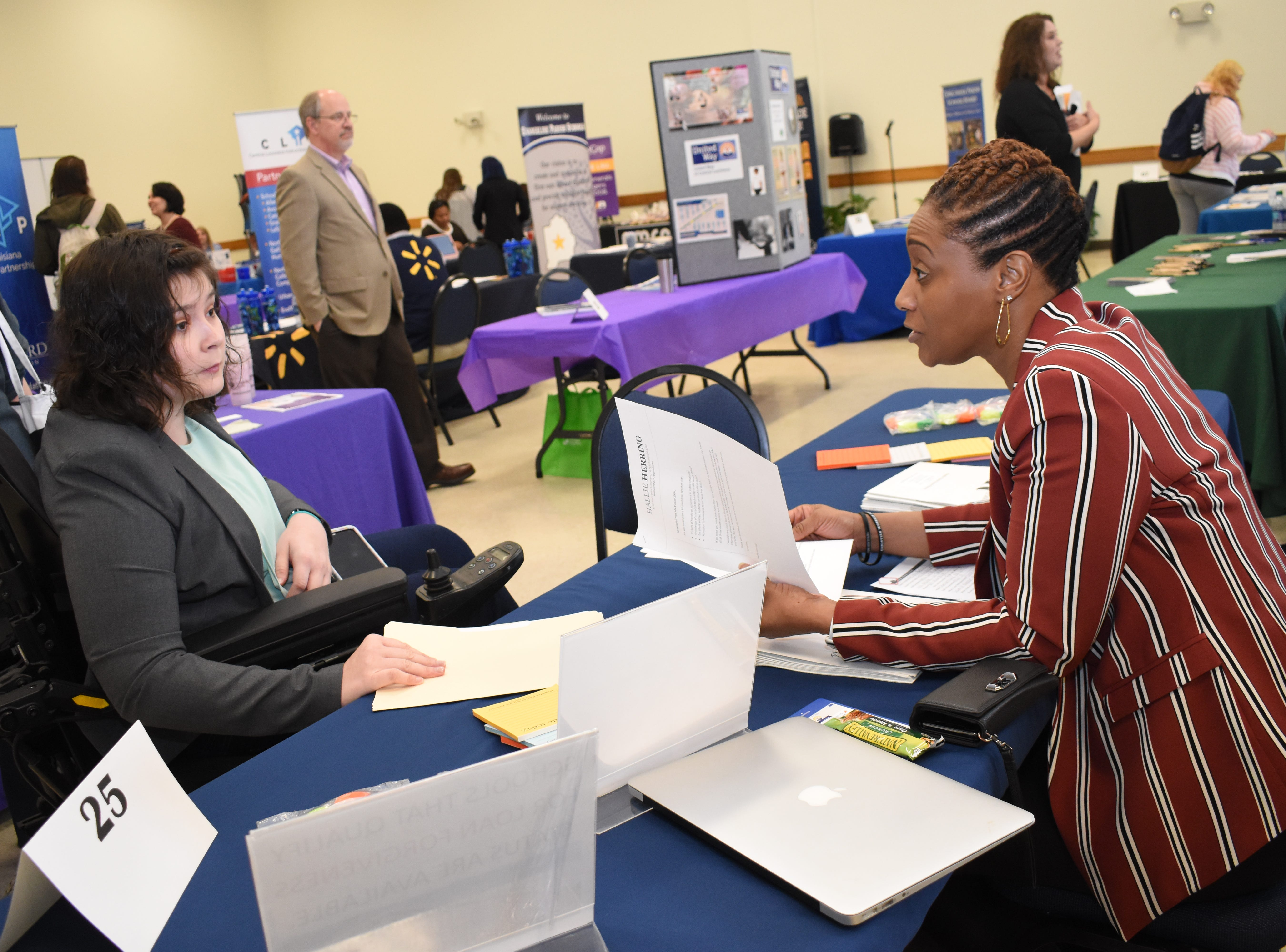 Hallie Herring (left), an LSUA senior, talks to Naomi Jones, director of human resources for the Rapides Parish School Board, at the Spring Career Fair held Tuesday, March 12, 2019 on the LSUA campus. About 40 businesses such as those involved in education, health care, non-profits and law enforcement were on hand to talk to students and others about job opportunities.