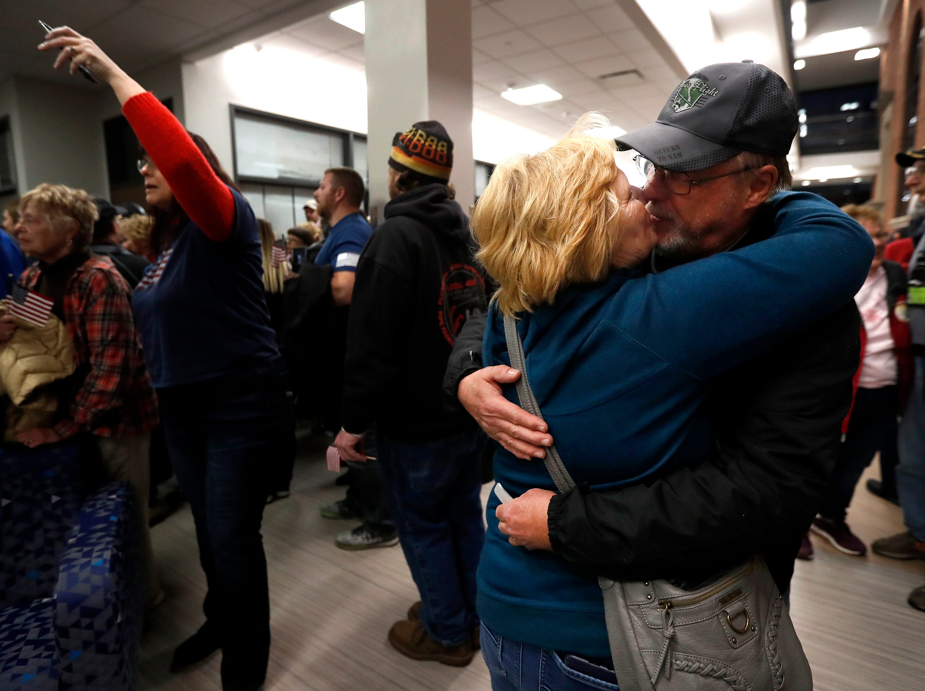 Dick Furman kisses his wife Joanne, of New London, during the Old Glory Honor Flight-Return to Nam welcome home Saturday, March 9, 2019, at Menasha High School in Menasha, Wis. Veterans were greeted by friends, family, the Menasha High School band, and the 484th Army Band. The couple was married in 1971 just before Dick went to Vietnam.Danny Damiani/USA TODAY NETWORK-Wisconsin