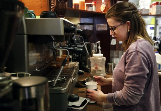 Christina McCarty works part-time as a barista at Copper Rock Coffee in downtown Appleton to save money for college.