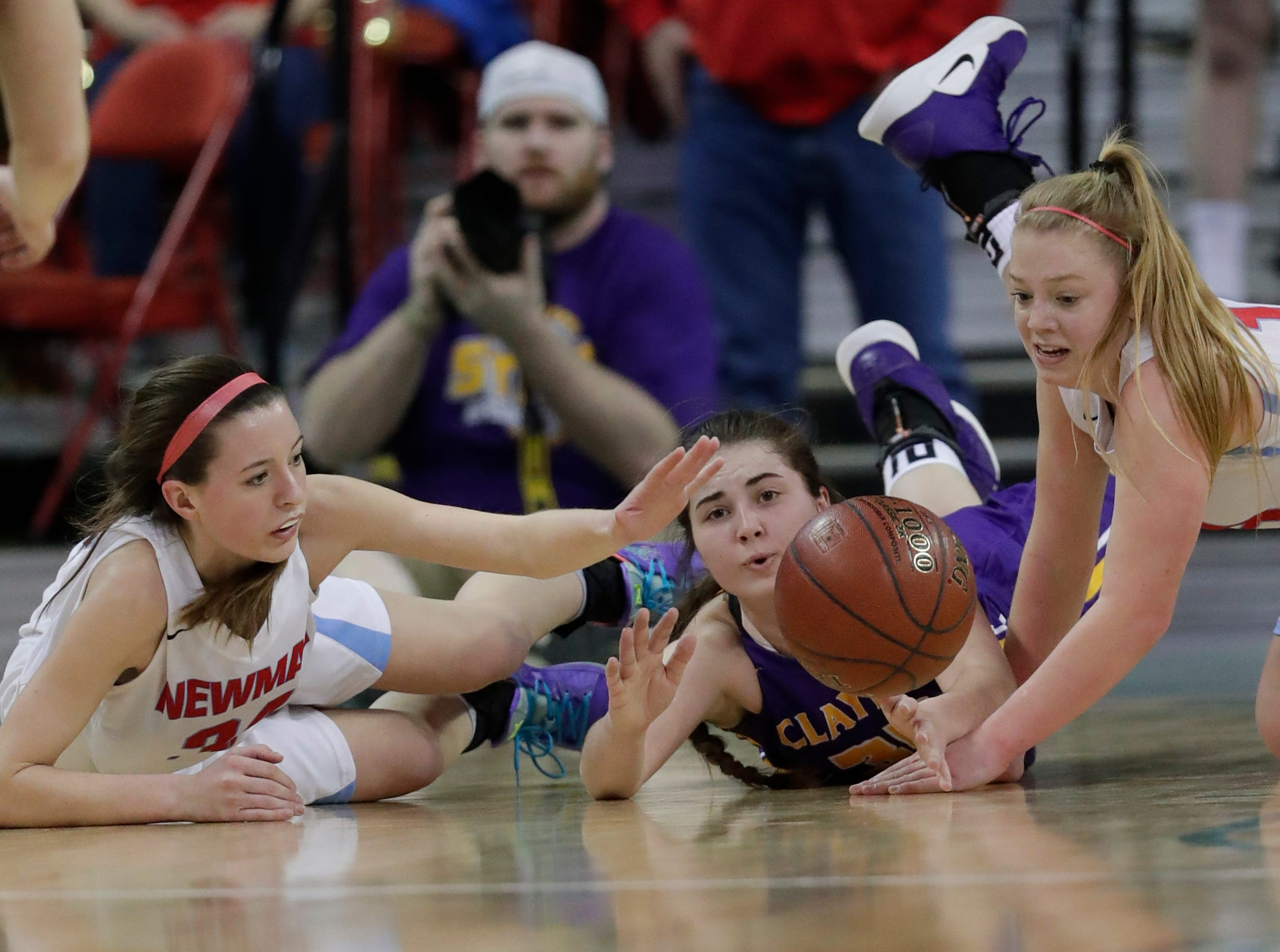 Wausau Newman Catholic's Julia Seidel (34) and  Mackenzie Krach (12) battle for a loose ball against Clayton's Kennedy Patrick (35)during their Division 5 semifinal game at the WIAA girls state basketball tournament Friday, March 8, 2019, at the Resch Center in Ashwaubenon, Wis. Dan Powers/USA TODAY NETWORK-Wisconsin