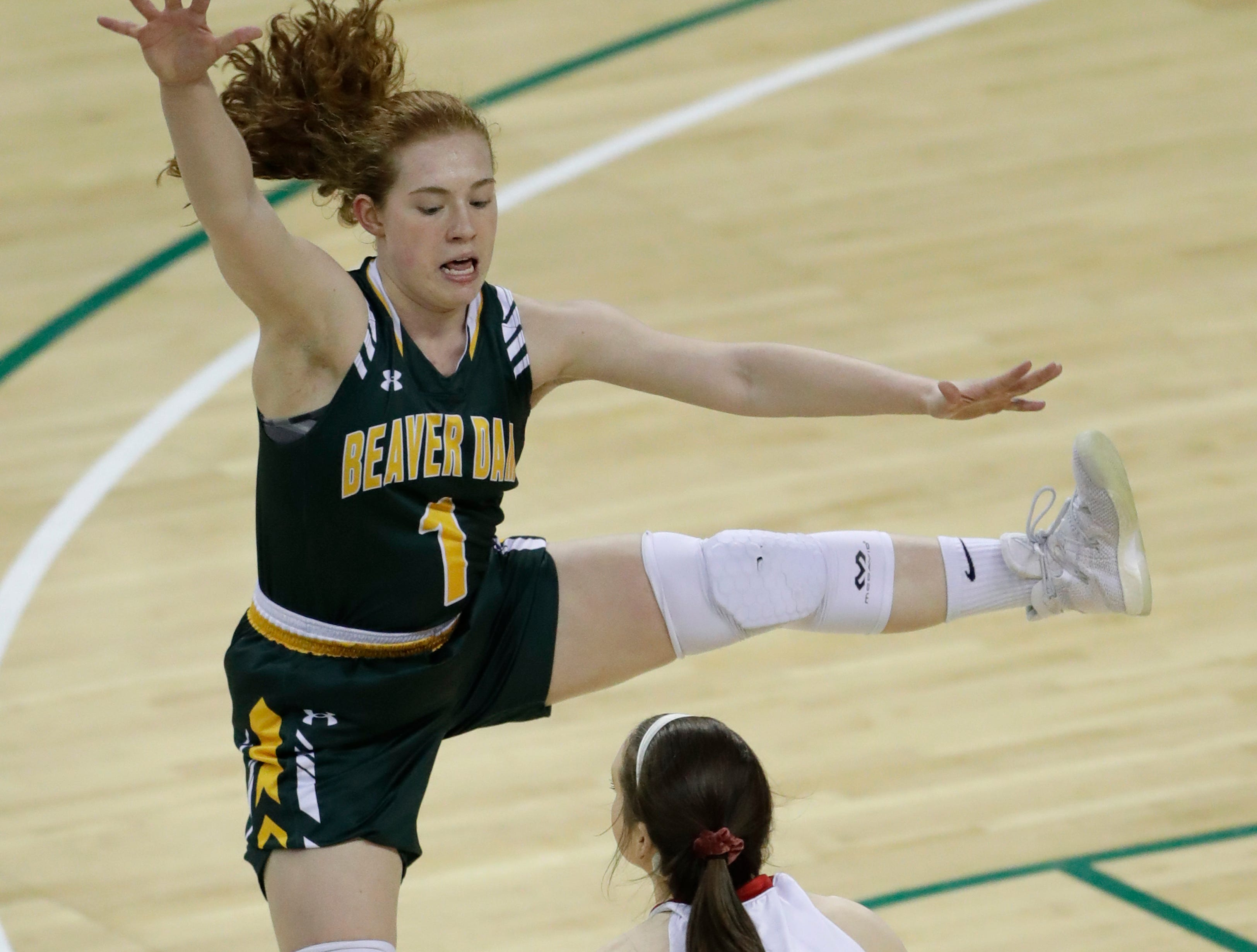 Beaver Dam's Natalie Jens (1) defends against Hortonville's Emily Nelson (21) during their Division 2 semifinal game at the WIAA girls state basketball tournament Friday, March 8, 2019, at the Resch Center in Ashwaubenon, Wis. Dan Powers/USA TODAY NETWORK-Wisconsin