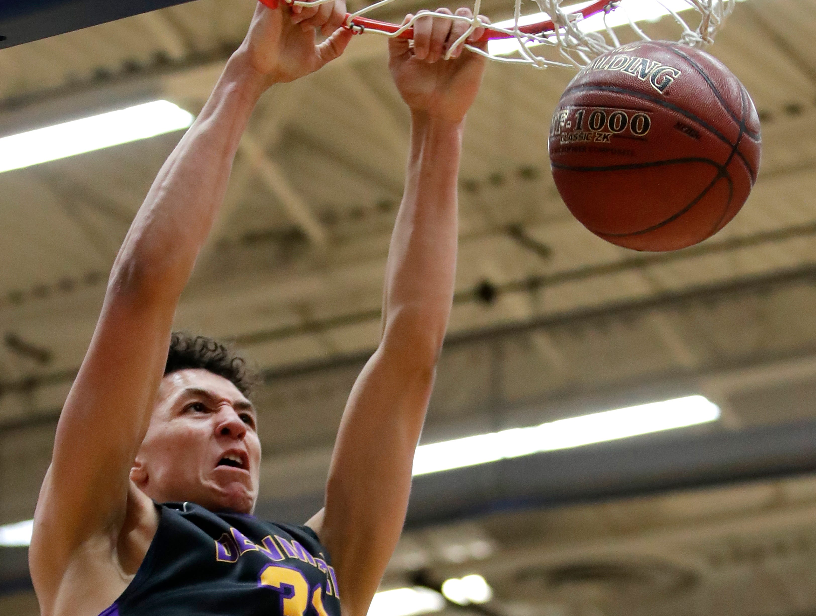 Denmark High SchoolÕs Patrick Suemnick dunks the ball on Freedom High School during the D3 sectional final Saturday, March 9, 2019, at Appleton North High School in Appleton, Wis.Danny Damiani/USA TODAY NETWORK-Wisconsin