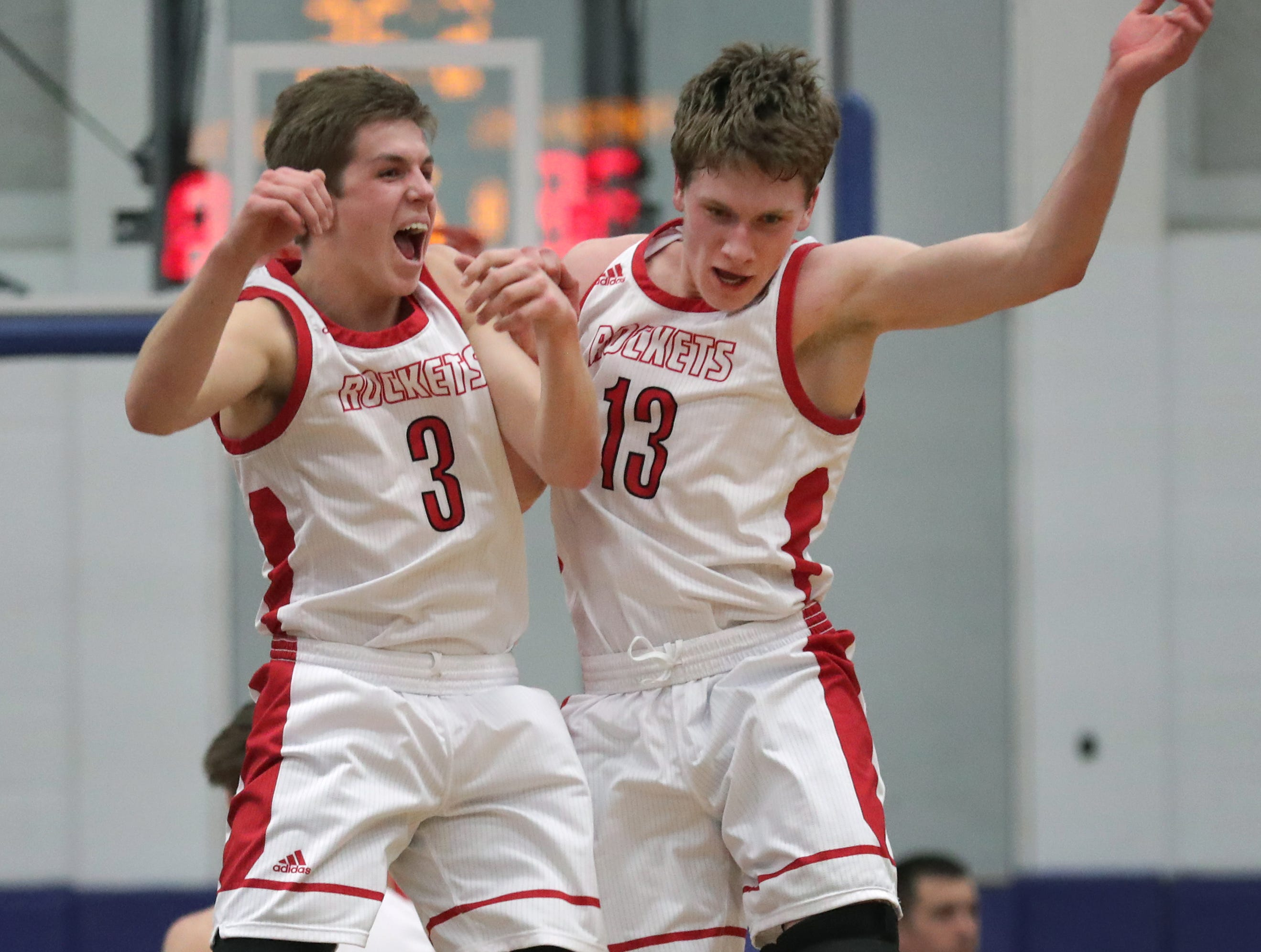 Neenah High School's #3 Sam Dietrich and #13 Ethan Parker against Kimberly High School during their WIAA Division 1 boys basketball sectional semi-final on Thursday, March 7, 2019, at Oshkosh West High School in Oshkosh, Wis. Neenah defeated Kimberly 57 to 56.Wm. Glasheen/USA TODAY NETWORK-Wisconsin.