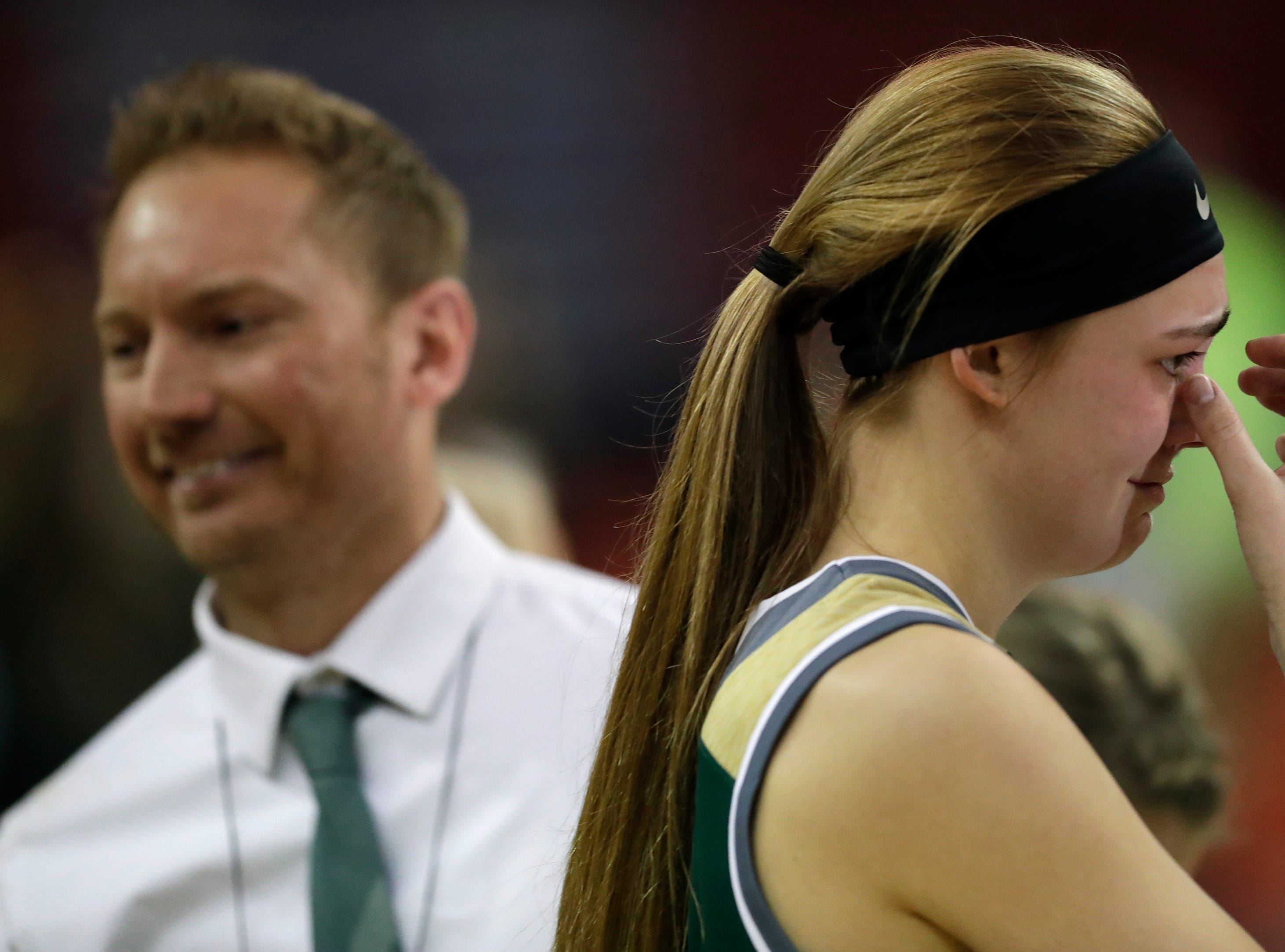 Laconia's Maci Grade (24) wipes away a tear after getting a hug from her coach Chris Morgan in a 64-56 loss to Marshall during their Division 3 championship game at the WIAA girls state basketball tournament Saturday, March 9, 2019, at the Resch Center in Ashwaubenon, Wis. Dan Powers/USA TODAY NETWORK-Wisconsin