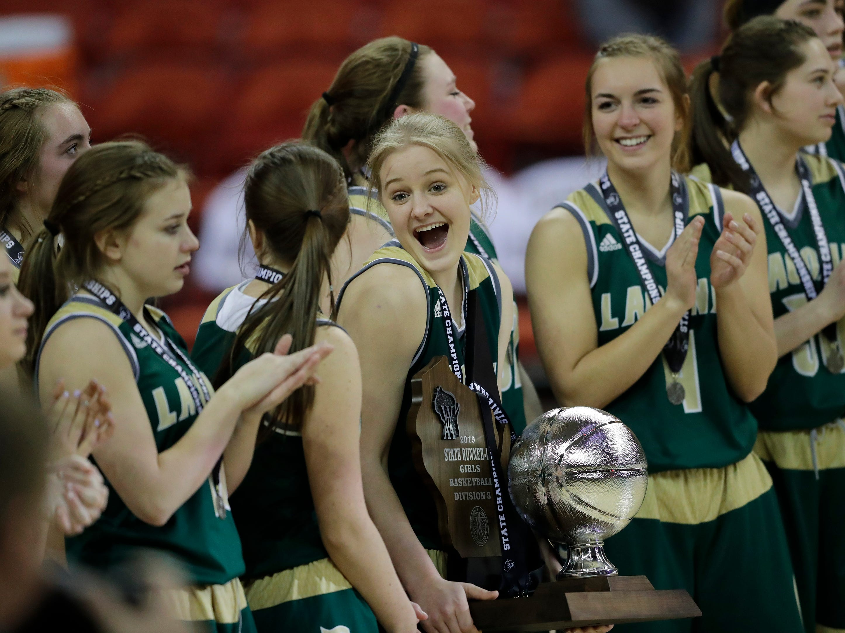 Laconia's Faith Weed (11) has a little fun with the runner-up trophy after a 64-56 loss to Marshall during their Division 3 championship game at the WIAA girls state basketball tournament Saturday, March 9, 2019, at the Resch Center in Ashwaubenon, Wis. Dan Powers/USA TODAY NETWORK-Wisconsin